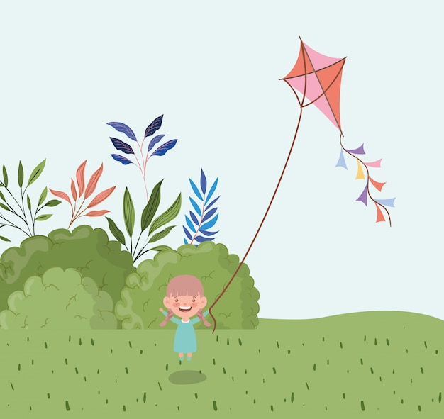 Niña feliz volando cometa en el paisaje de campo