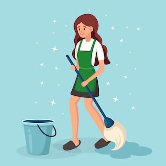 Niña lava el piso con un trapeador y una canasta de agua. limpieza del hogar, concepto de limpieza. rutina diaria, actividad de personas.