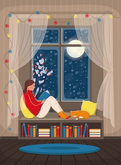Una niña leyendo un libro en el alféizar de la ventana. interior acogedor con ventana de nieve, estantería y con un gato.