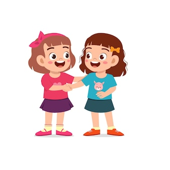 Niña linda con un apretón de manos con su amiga