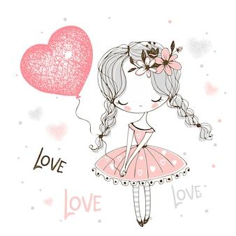 Niña linda con un globo en forma de corazón. enamorado.