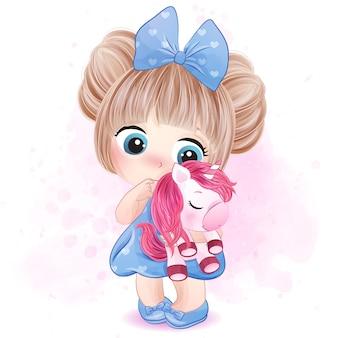 Niña linda que abraza una ilustración del unicornio