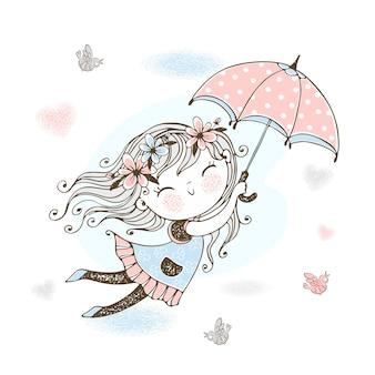 Niña linda volando en un paraguas.