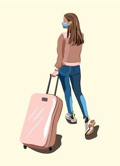 Una niña con una máscara en el rostro y con una maleta con ruedas viaja en avión