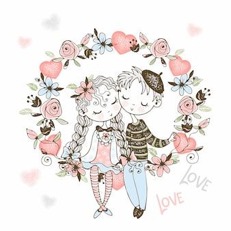 Una niña y un niño enamorado se sientan en un arco de flores.
