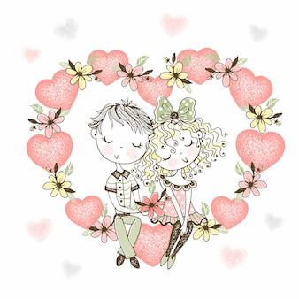 Una niña y un niño enamorados se sientan en un gran corazón de flores.