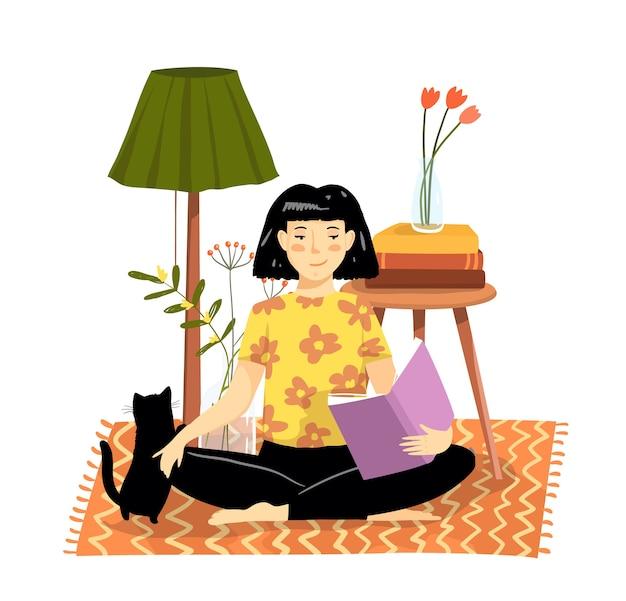 Niña o mujer sentada en la alfombra del piso en casa leyendo un libro en un cómodo apartamento acogedor