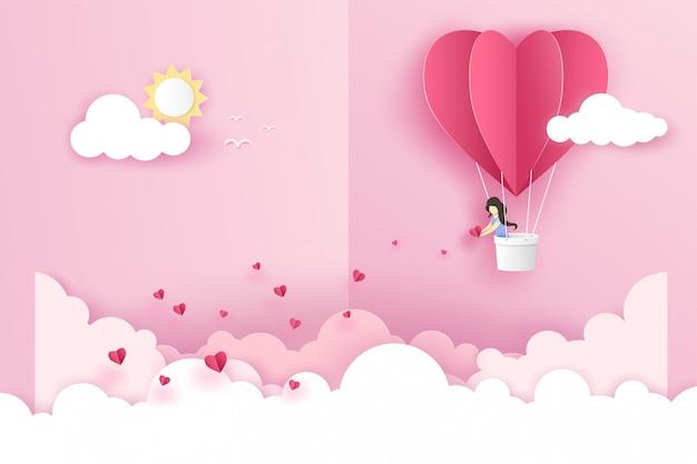 Una niña en origami rosa globo corazón volando con muchos mini corazones en el cielo sobre la nube en el día de san valentín.