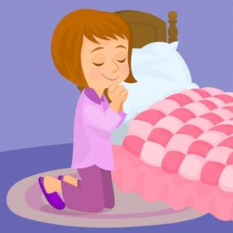 Niña rezando junto a su cama