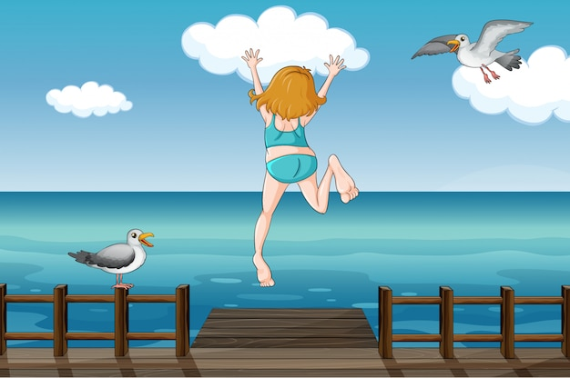 Una niña saltando en el agua