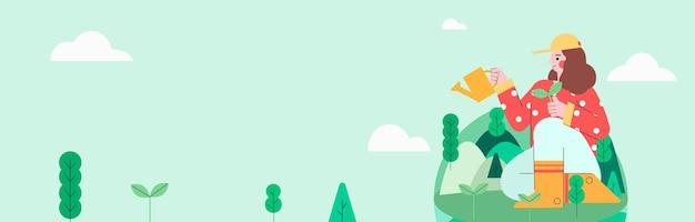 Niña sentada en una tierra verde plantando árboles