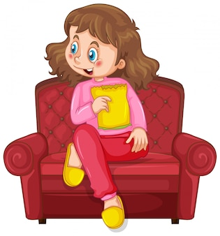 Niña en el sofá comiendo bocadillos sobre fondo blanco.