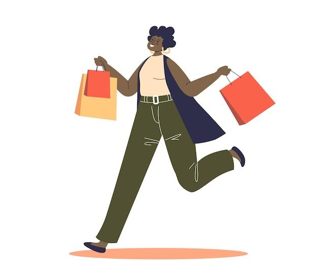Niña sosteniendo bolsas de la compra feliz después de comprar en oferta y precios de descuento