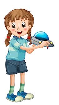 Una niña sosteniendo el personaje de dibujos animados de juguete cohete aislado sobre fondo blanco.