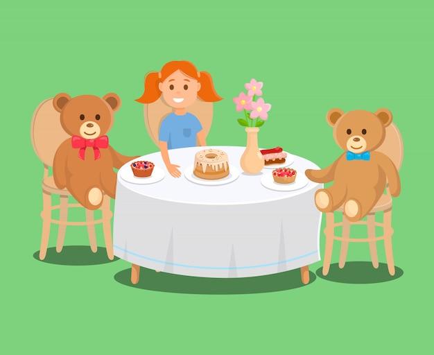 Niña sostiene plato con pastel, oso juguetes con magdalenas.