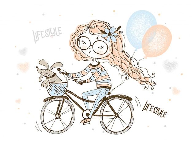 Una niña con su perro mascota monta una bicicleta con globos.