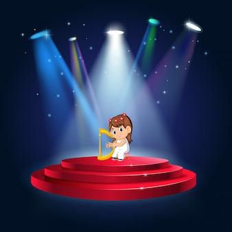 Una niña tocando el arpa en el escenario