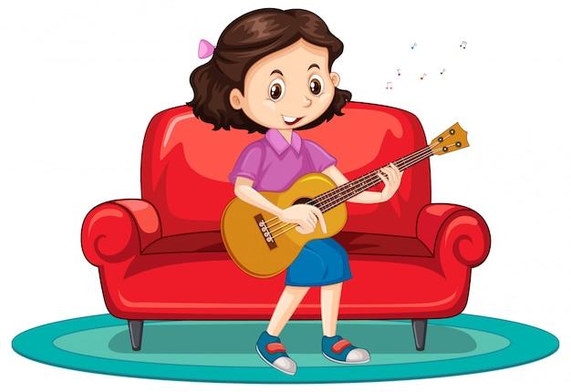 Niña tocando la guitarra en el sofá
