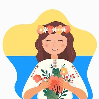 Niña ucraniana en el traje folklórico con flores, corona y bandera nacional de ucrania. feliz independencia, día de la constitución