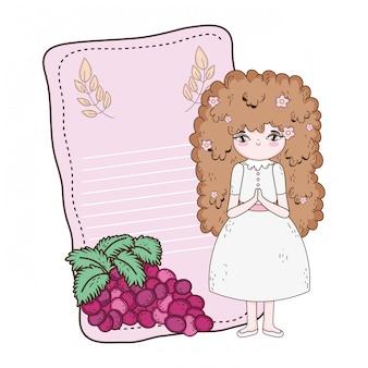 Niña con uvas uvas en comunión celebración