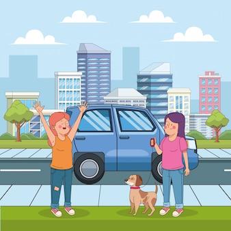 Niñas adolescentes felices de dibujos animados en la calle con un perro