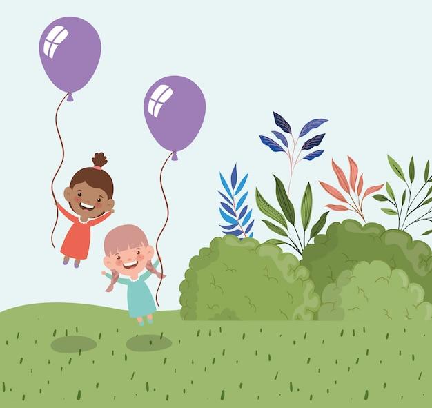 Niñas felices con globos de helio en el paisaje de campo