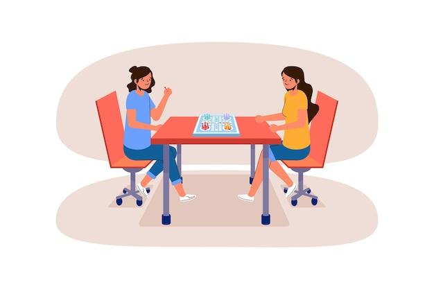 Niñas jugando juego de ludo