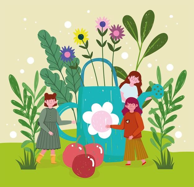 Niñas con regadera de jardín