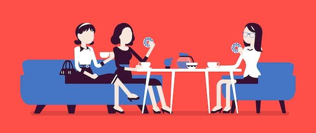 Niñas sentadas en un café