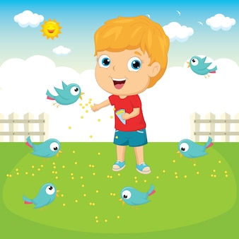 Niño alimentando pájaros