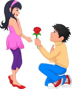 Niño se arrodilla sobre una rodilla dando flores a la niña
