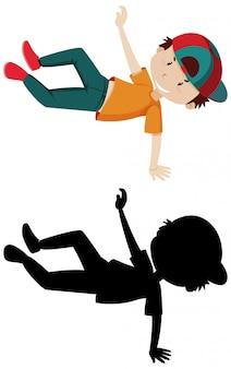 Niño bailando con su silueta