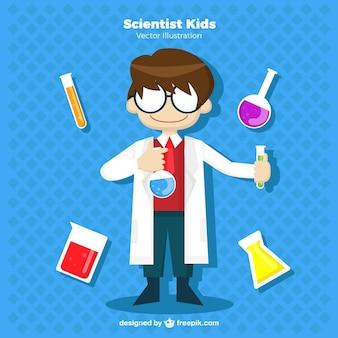 Niño científico con gafas y elementos de laboratorio