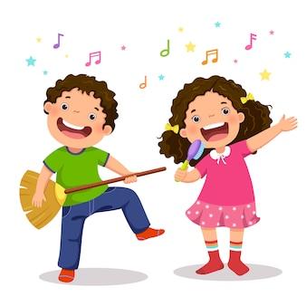 Niño creativo tocando guitarra virtual con escoba y niña cantando con cepillo para el pelo
