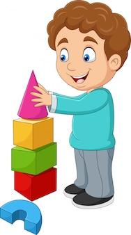 Niño de dibujos animados jugando con bloques de construcción