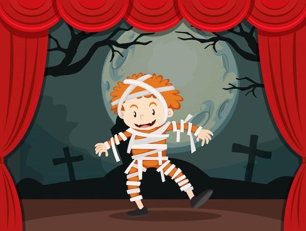 Niño disfrazado de zombie en el escenario.