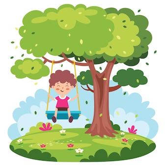 Niño divertido jugando en un columpio