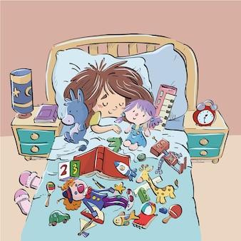 Niño durmiendo en la cama rodeado de juguetes.