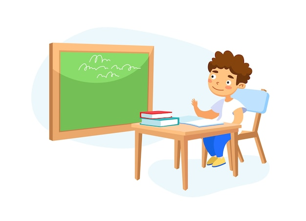 Niño de escuela niño feliz sentado en el escritorio en el aula estudiando