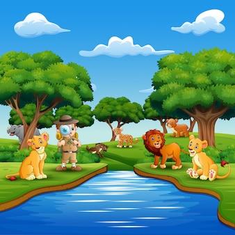 Niño explorador de dibujos animados con animales junto al río.