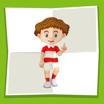 Niño feliz apuntando el dedo hacia arriba