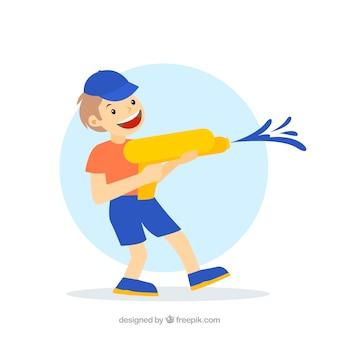 Niño feliz jugando con pistola de agua