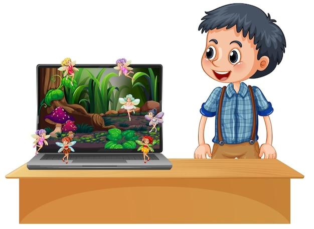 Niño feliz junto a la pantalla del cuento de hadas de la computadora portátil
