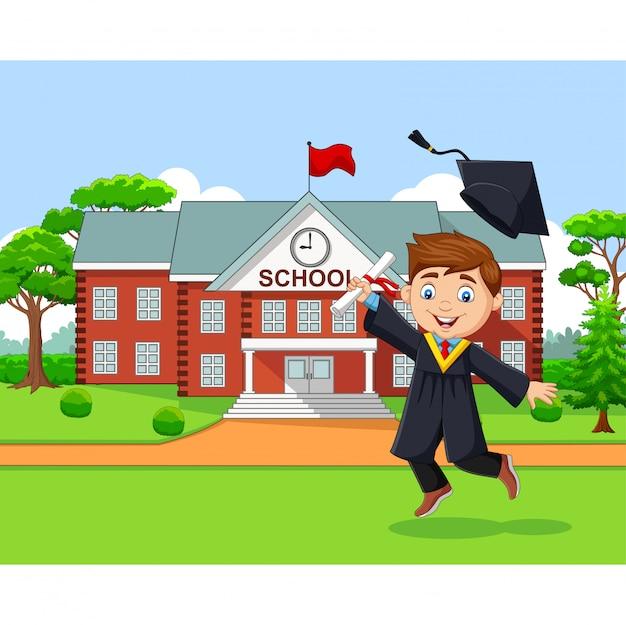 Niño de graduación de dibujos animados en frente del edificio de la escuela