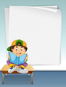 Niño leyendo libro con fondo de marco de página para copyspace