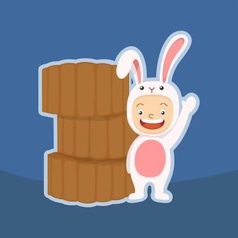 Niño lindo disfrazado de conejo y pastel de luna