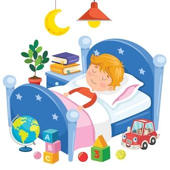 Niño lindo durmiendo en la cama