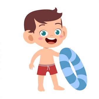 Niño lindo feliz con anillo de natación