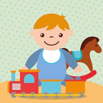 Niño lindo con juguetes de vagones de tren de caballo mecedora