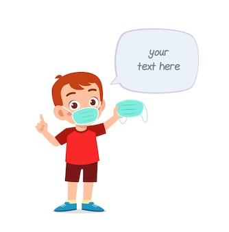 Niño con máscara y advertir sobre virus.